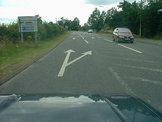 Featherbed Lane junction showing bifurcation arrow - never use these!